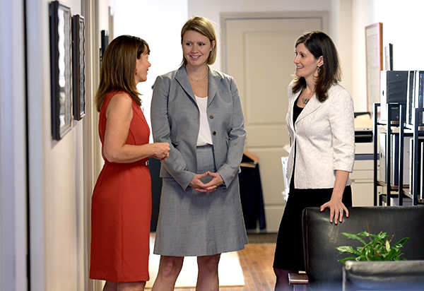 Jennifer Salvatore, Sarah Prescott, Julie Porter in hallway conversation.