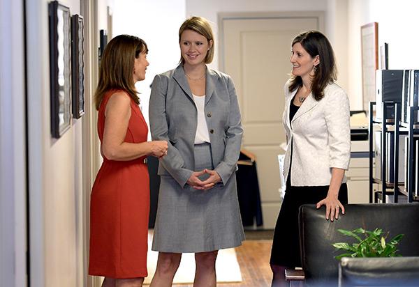 Jennifer Salvatore, Sarah Prescott, Julie Porter in hallway conversation.